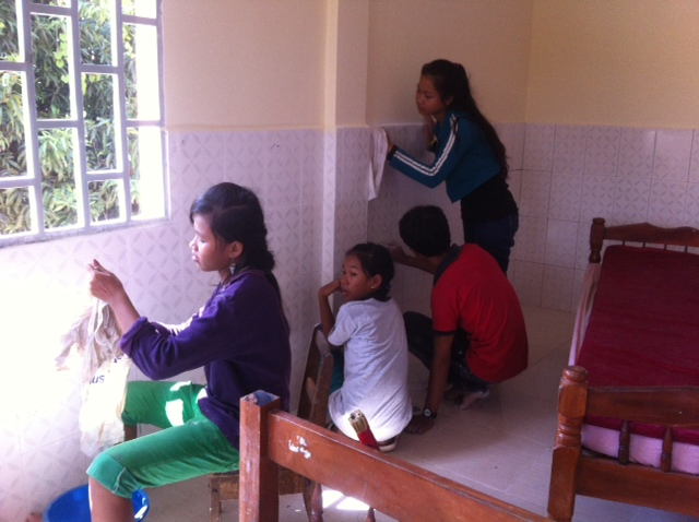 The kids from Prek Eng 3 put the final polish on the rooms at the new home.