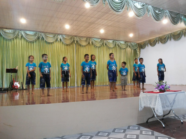 The kids of Battambang 4 take to the stage during church.