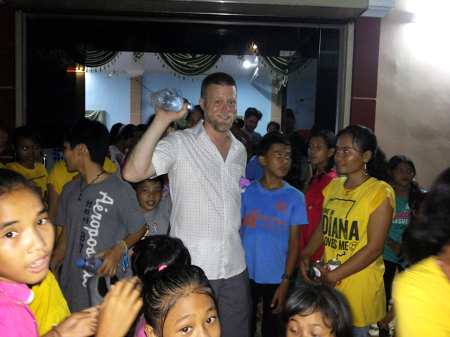 Executive Director, John McCollum, gets sweaty at a Battambang dance party.