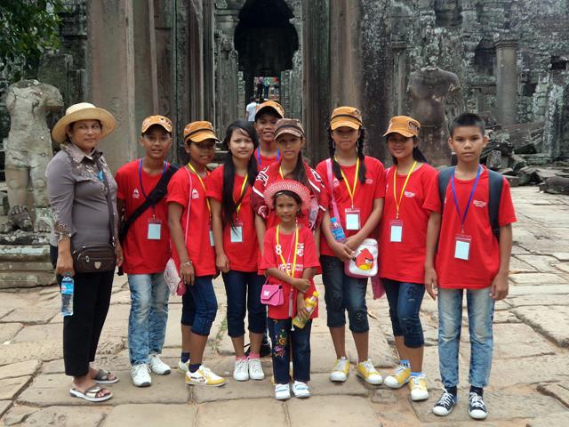 Enjoying a visit to the ancient Angkor Wat temple.
