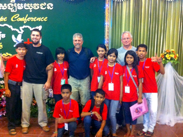 Mike Hunsader and other guests pose at church with the staff and kids of Prek Eng 5.