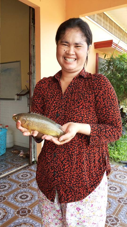 Kimchou, BB4's mom, makes the best of the situation, catching fish in the front yard that is now a lake.