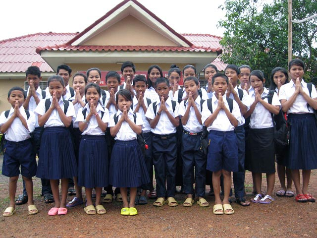 The kids of Battambang 2 posing in their new school uniforms.