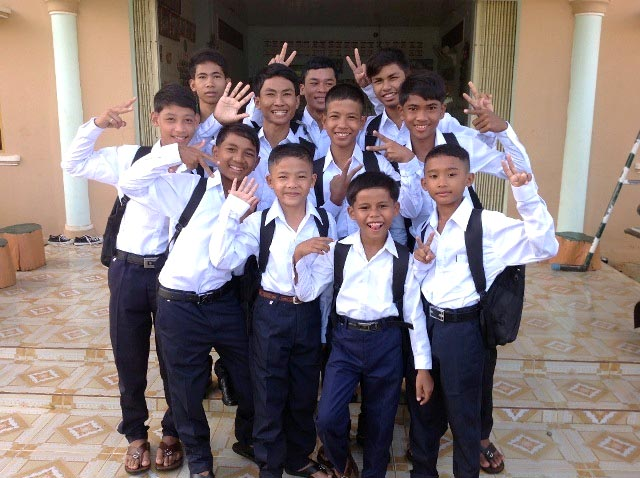 The kids of Battambang 3 enjoying their crisp new school uniforms.
