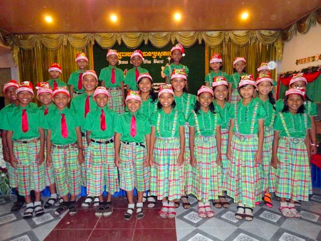 The children of Battambang 7 pose for a pre-performance photo at a special Christmas outreach.