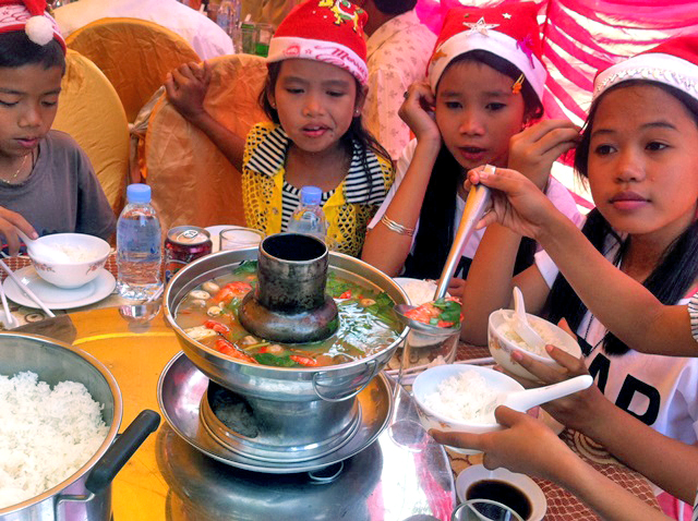 The kids enjoy one of many celebratory meals over the Christmas season.