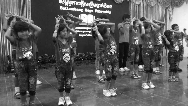 The kids of Battambang 9 perform for Battambang Hope Fellowship.