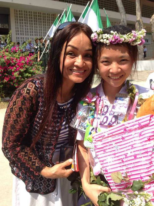 Our wonderful National Director of Asia's Hope Thailand, Tutu Bergphasanti, poses with one of the hard-working young graduates.