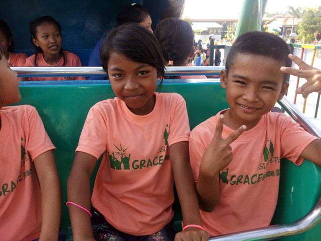 The kids enjoyed a special trip to a local amusement park with the members of their sponsoring church.