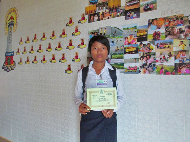 Showing-off her certificate for outstanding achievement achievement
