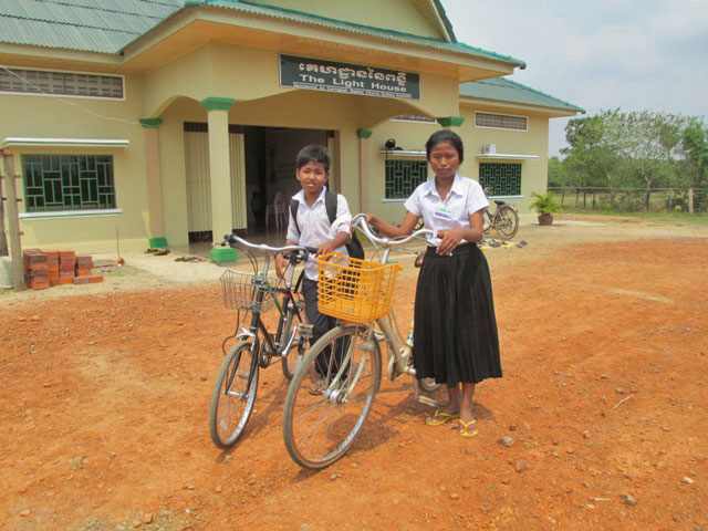 Getting ready to head to school on their new bikes!