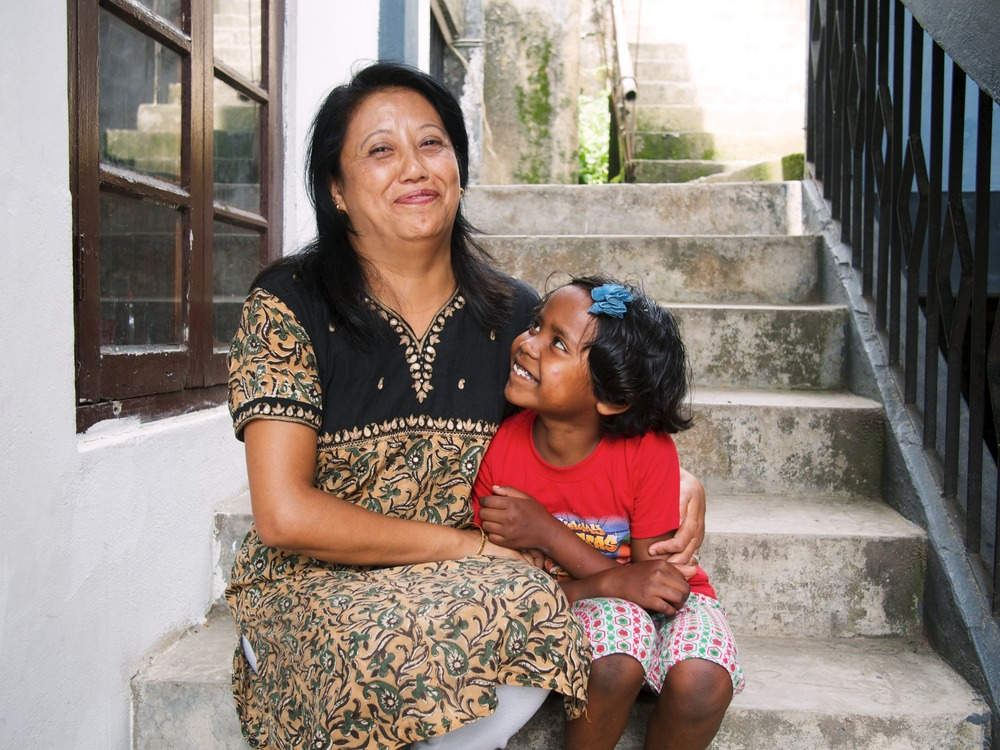 Poonam, Home Parent of Kamlimpong 2, with one of her many beautiful daughters.