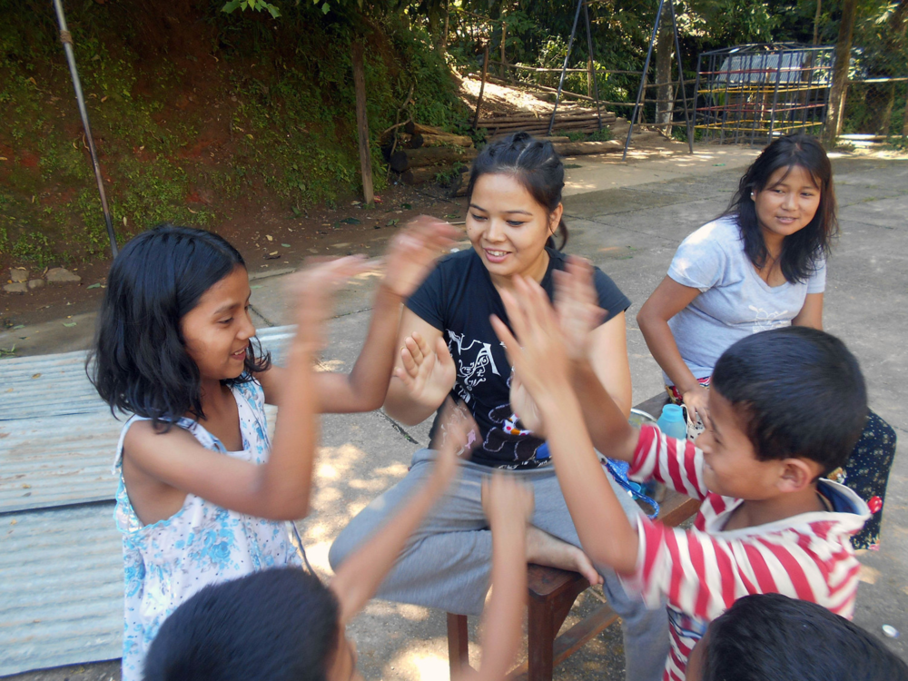 Playing games in the courtyard outside of the Kalimpong 3 home.