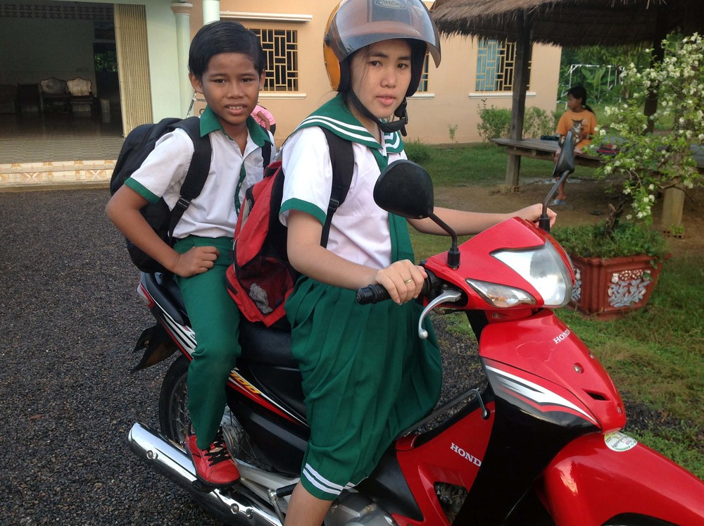 School is back in session! Two of our talented scholars head to a local private school on their moto.