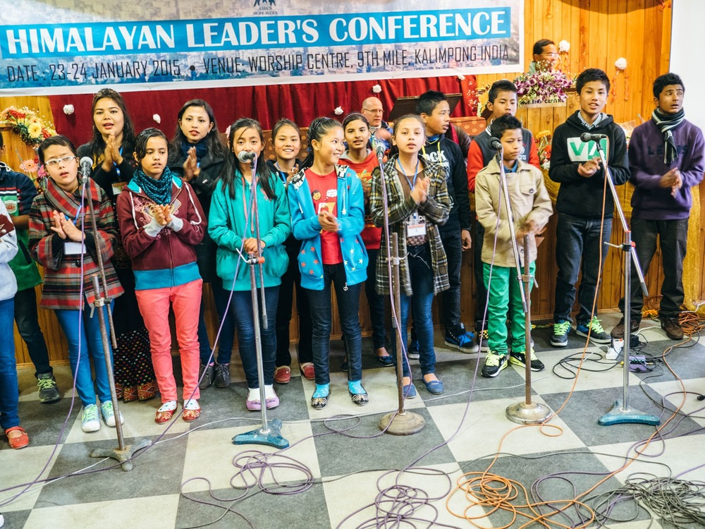 Asia's Hope kids leading in song at the Himalayan Leaders Conference in January.