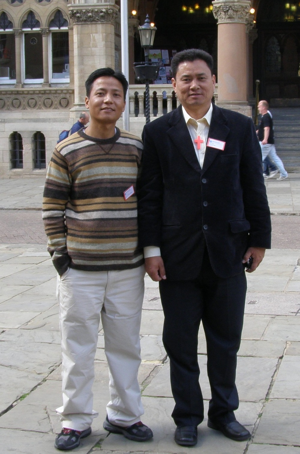 Pastor N____, pictured with Pastor Eliya who passed away with his eldest son during the quake.