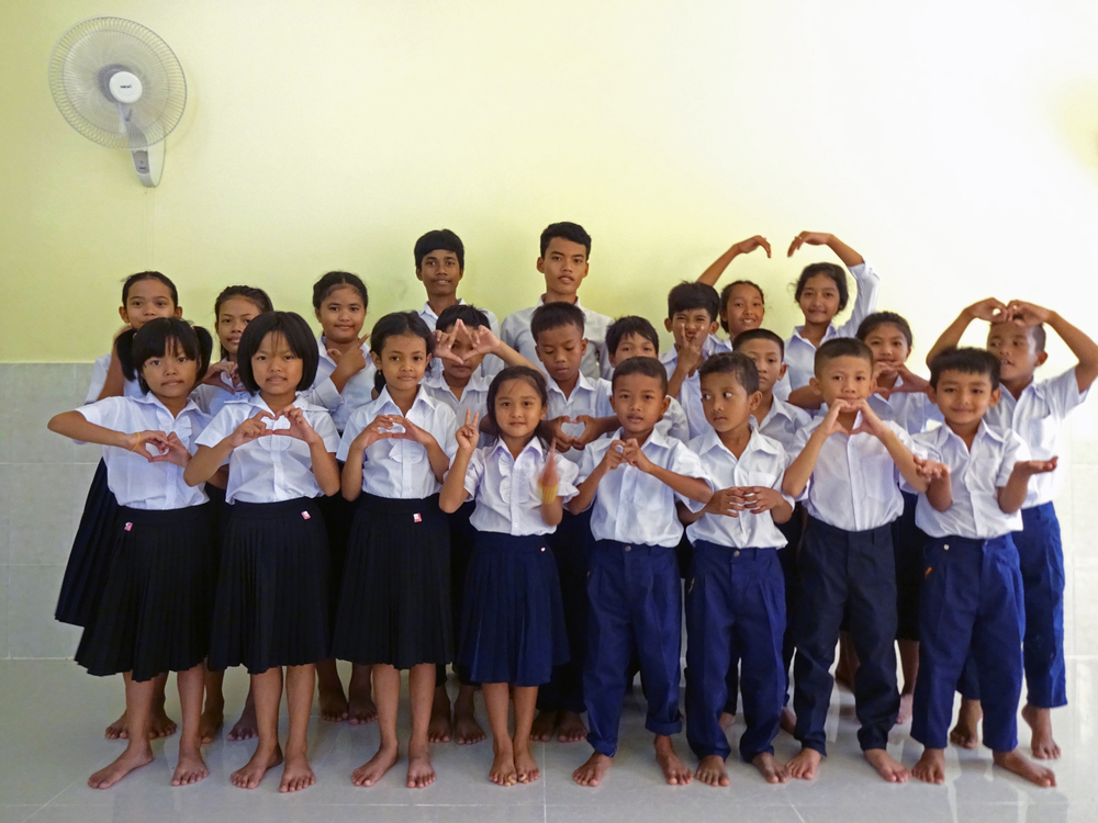 New school uniforms for the kids! Many of these children will attend school for the first time in their young lives.