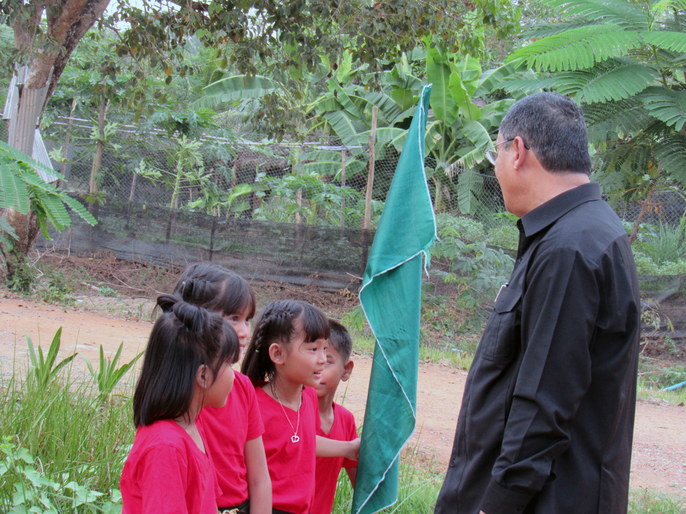 The Governor of Battambang with the Battambang 9 kids at the Asia's Hope Christmas Outreach!