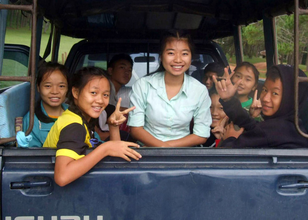 The kids participate in an outreach to a remote hill tribe village.