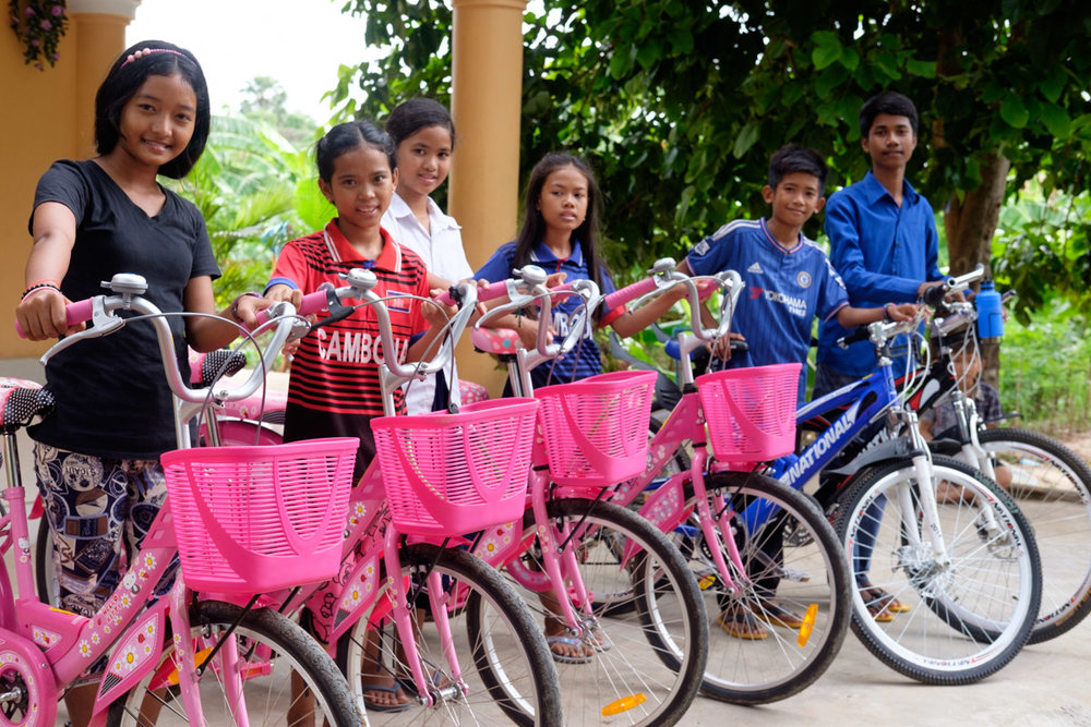 Children at the Prek Eng 6 home proudly display their new EduGo bikes.