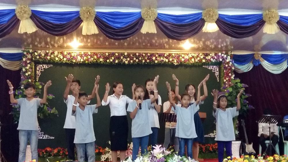 Performing during Sunday worship service in Prek Eng.