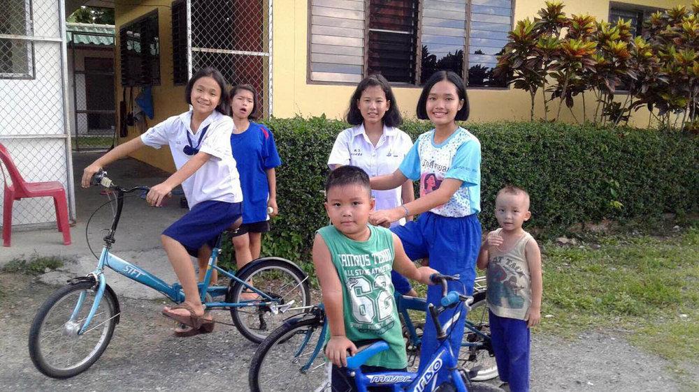 The kids enjoy some new bikes, courtesy of our funding partner EduGo!
