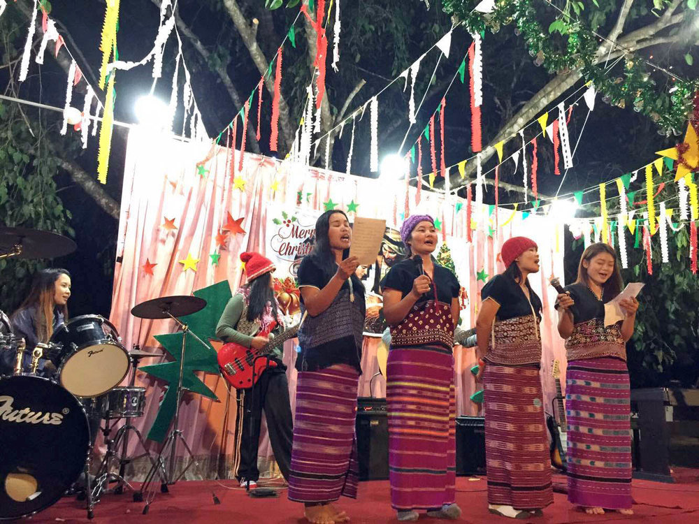 Asia's Hope staff perform during Christmas celebrations.
