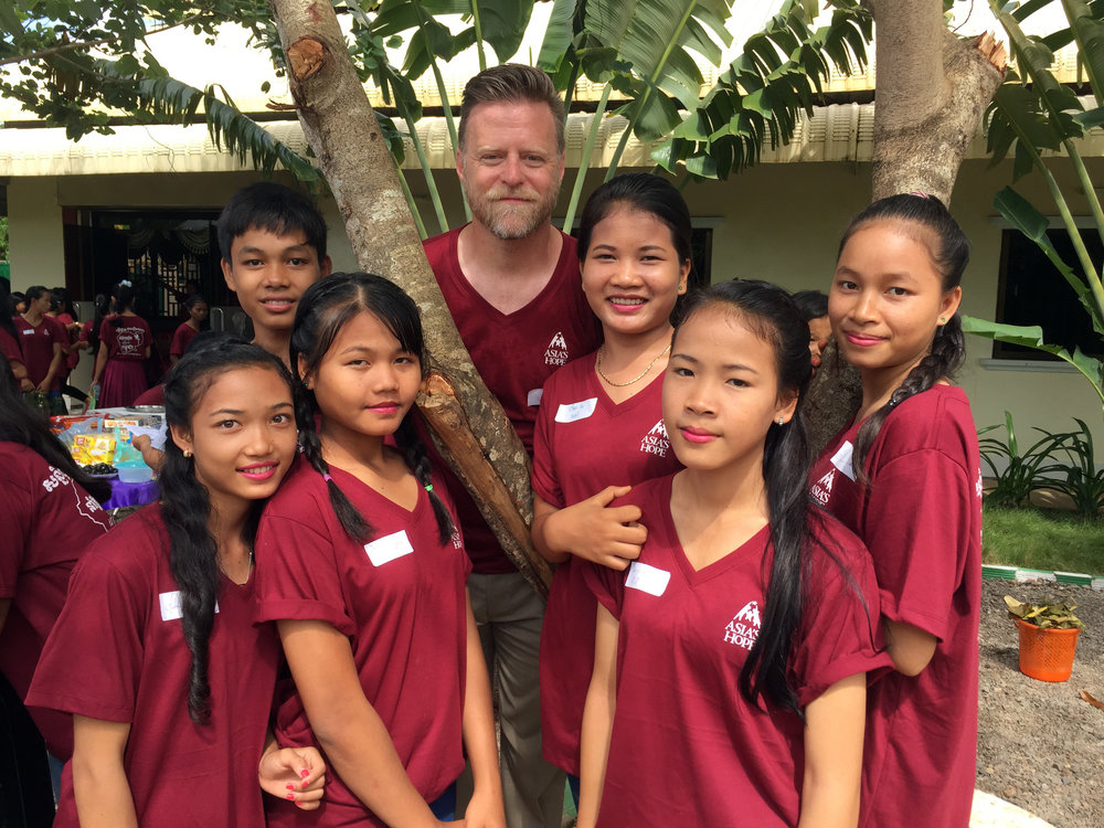 Executive Director, John McCollum, spending time with the Battambang 5 kids!