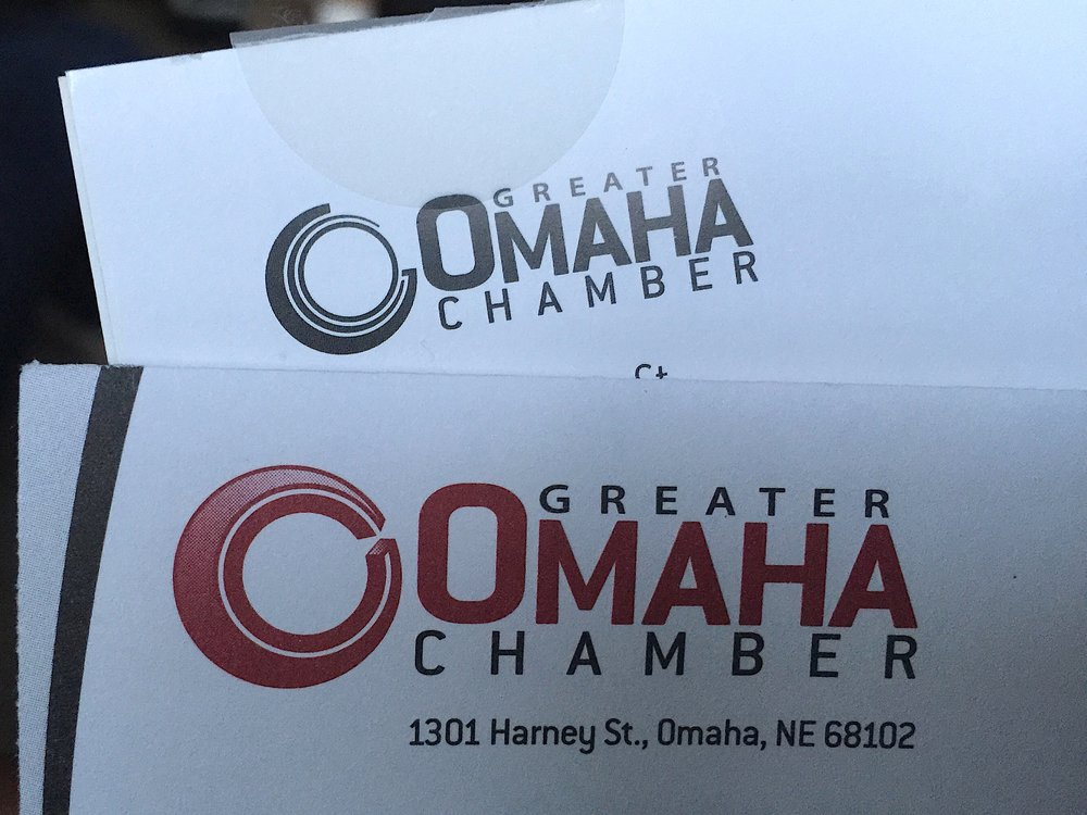Greater Omaha Chamber logo… previous (front), new (behind)