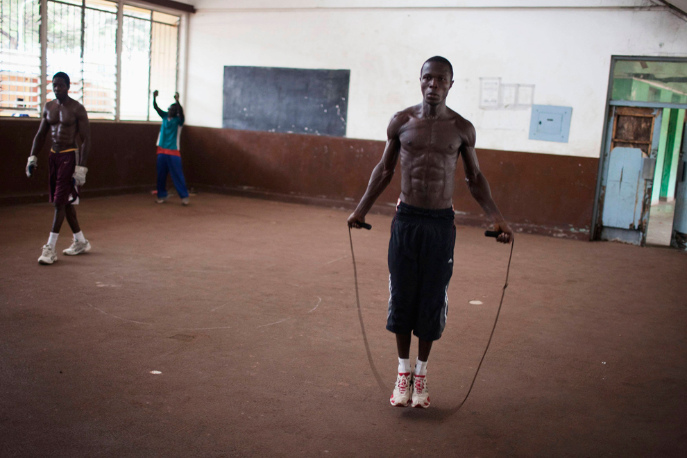 Olympic hopeful Abdul Rashid Bangura (27) jumps rope while training at the national stadium in Sierra Leone's capital of Freetown on April 25. Sierra Leone's national boxing team was scrambling to raise money to send athletes to an Olympic qualifying event starting in Morocco on Friday, but lack of financing and government support means the competition is likely out of reach for most of the national team. (Finbarr O'Reilly/Reuters)