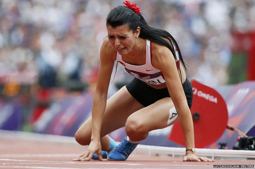 Turkey's Merve Aydin who suffered an injury during a heat of the 800m and finished.