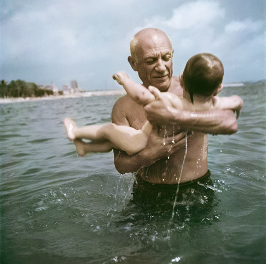 Pablo Picasso playing in the water with his son Claude, Vallauris, France, 1948.