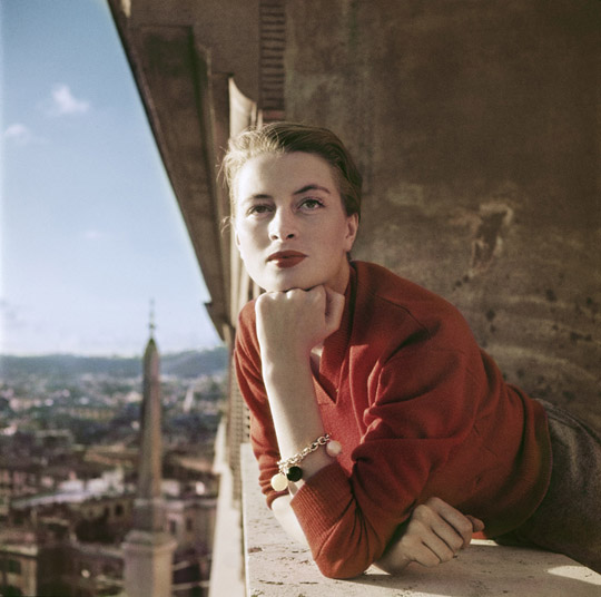 Capucine, French model and actress, on a balcony, Rome, Aug. 1951.