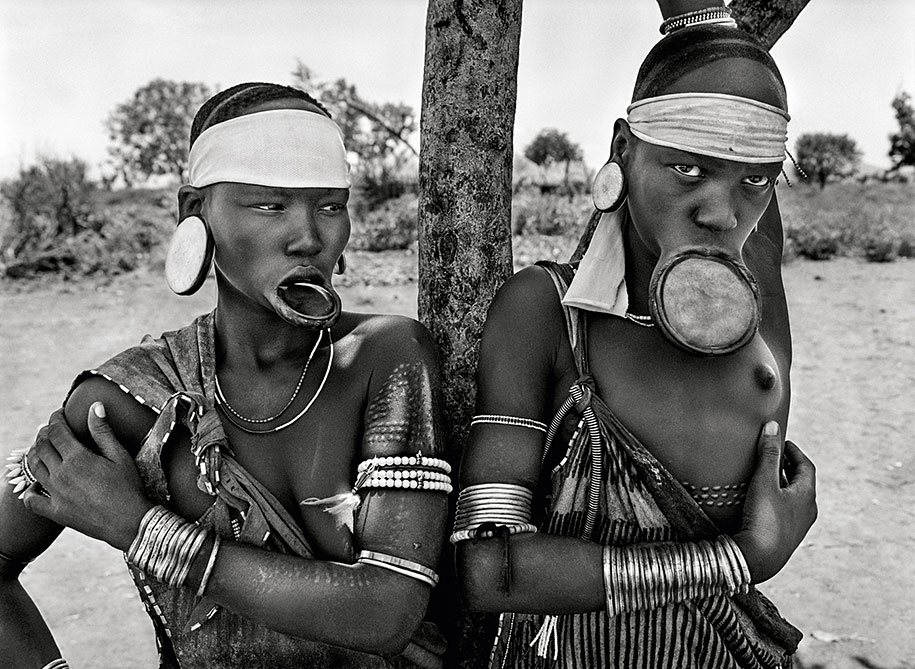 The Mursi and the Surma women in Ethiopia wearing lip plates as a mark of high birth (2007)