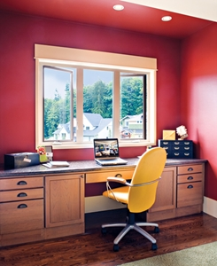 Bold red walls enliven this home office