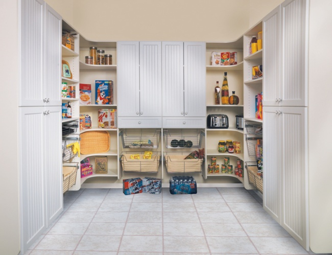 Talbot Door | White Melamine.  This generous pantry offers open storage for quick access to frequently used items and plenty of closed storage for everything else! The wire baskets are especially useful for cleaning supplies, snack bags, and other odd-sized items that don't stack well on shelves. All of the shelves in this 3-wall design are fully adjustable for maximum efficiency. The curved design of the corner modules keeps items from getting lost behind other products in deep, dark corners.
