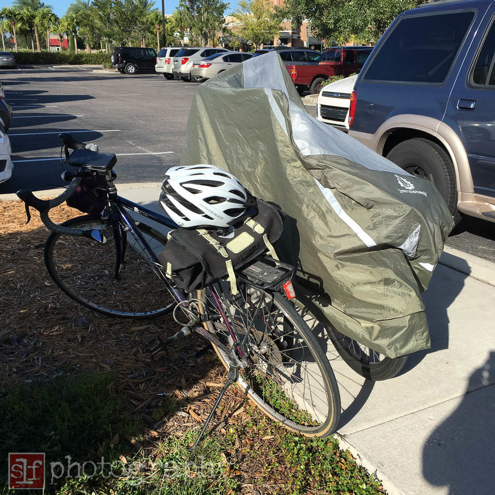 a cyclist at panera was hogging the lone bike rack with a cover for his bike. i locked up my bike and went inside.