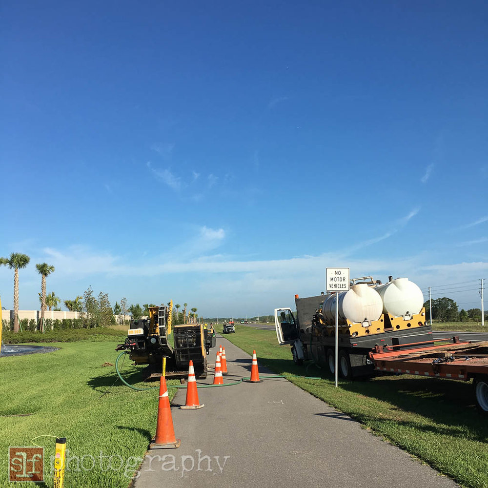 construction crew extending the gas line along SR56