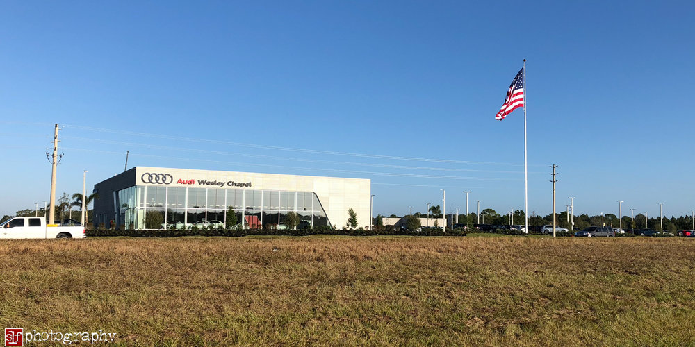 huge flag at audi dealership shows how windy is was