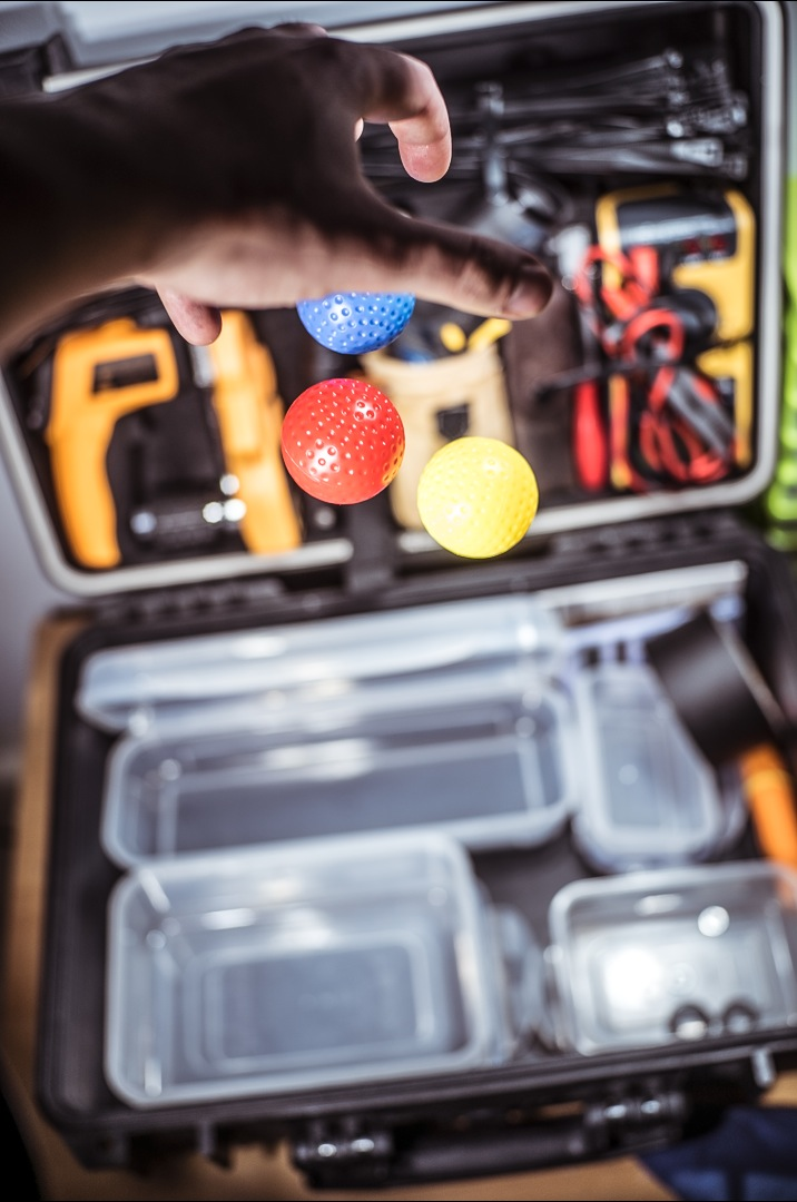 Me dropping some balls into my half-made tool box. Click for larger.