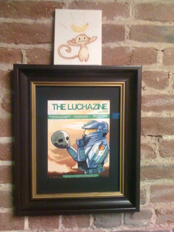 The Luchazine cover hanging in the Whiskey Media offices.