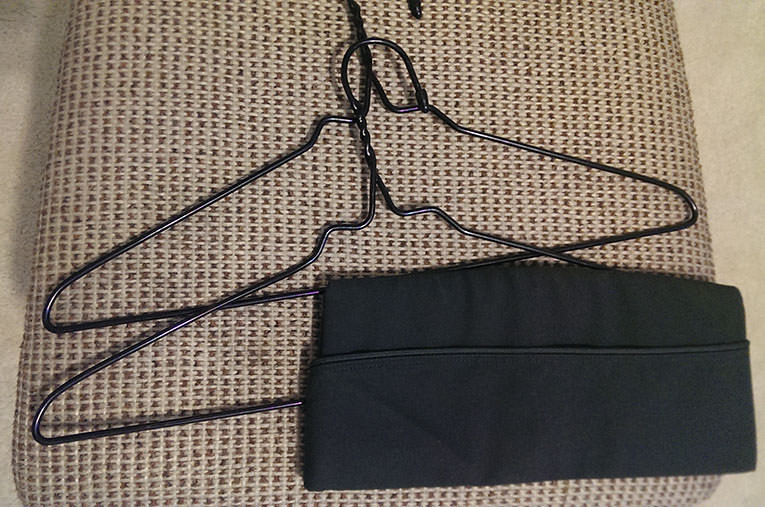 What was inside the $3 garment bag: two hangers and a  U.S. Army garrison cap.