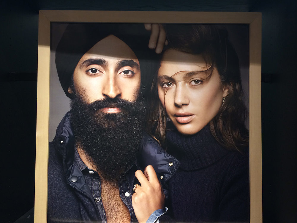 "The man on the left is Waris Ahluwalia, an actor and designer. The woman on the right is Quentin Jones, who describes herself as an ""animator, director, illustrator... with a boy's name."" on her Twitter profile. The photo is for Gap's ""Make Love"" campaign."