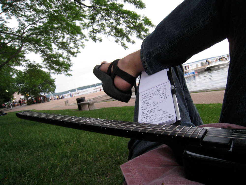 "Writing ""Old Wounds Still Bleed"" on the shore of Lake Mendota in Madison, Wisconsin"