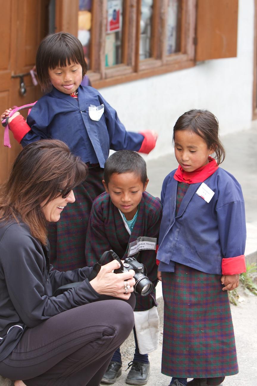 Taking pictures of school kids in Jakar