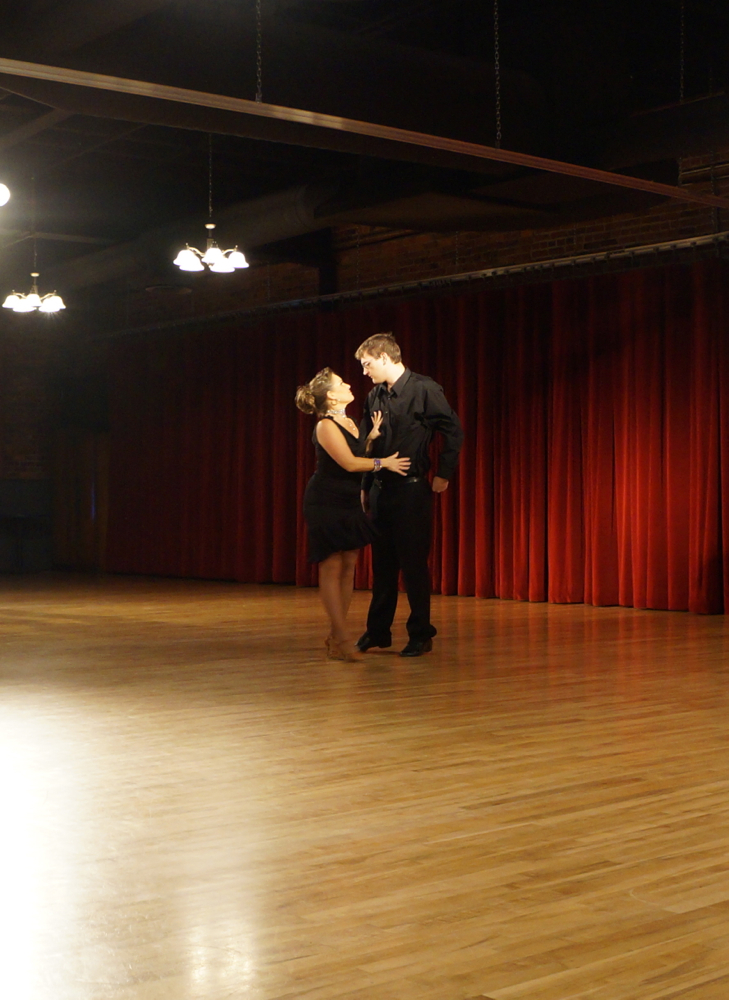 Theron Schamle with instructor Shelley Fritz performing their Rumba.