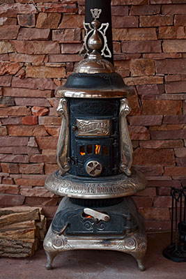 Round Oak wood stove, made circa 1913