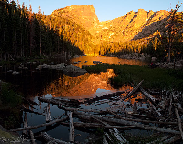 6:38 AM: Dream Lake as the rising sun strikes the mountain backdrop.
