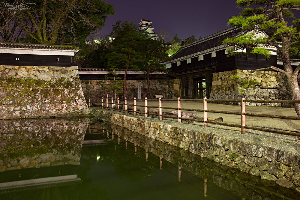 The main keep of Kochi Castle sits on a hill, and looks across fortified walls and moats into the town of Kochi below.