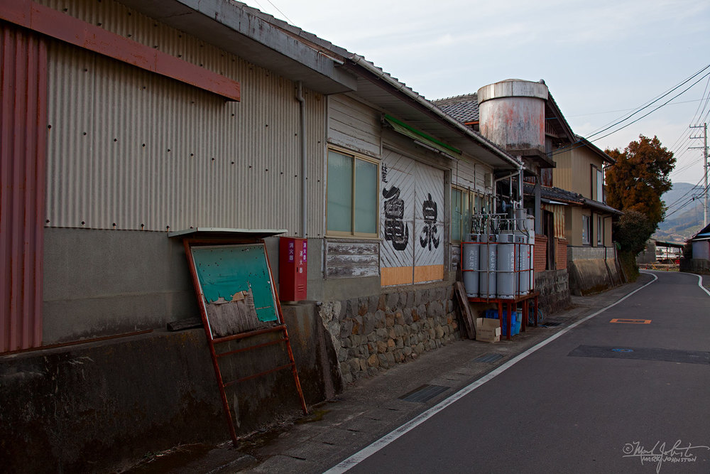 The unassuming facade of the Kame Izumi sake brewery.  But - - - magic happens inside!